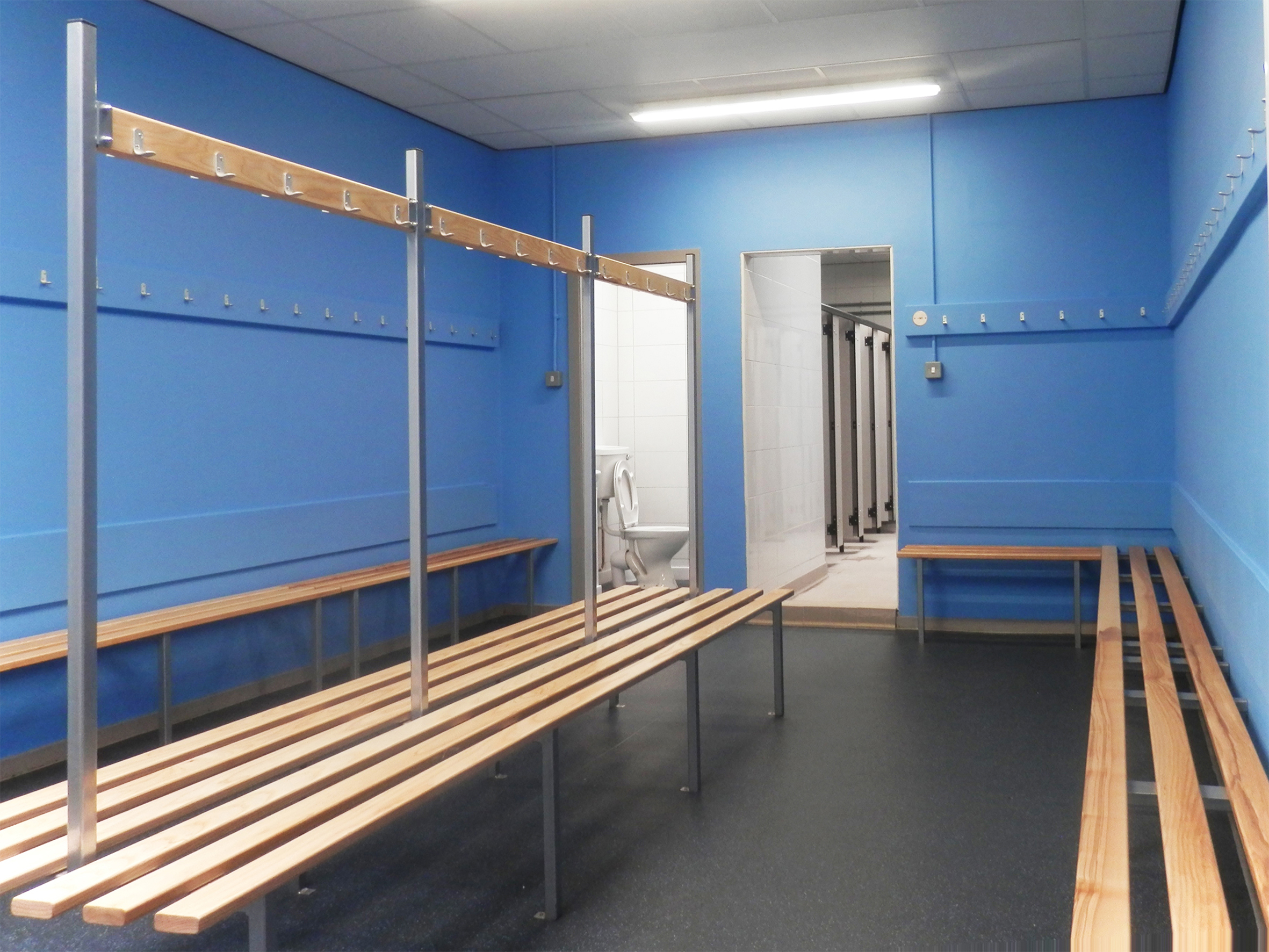 Changing area fitted with Formica impact cubicles and bespoke seating