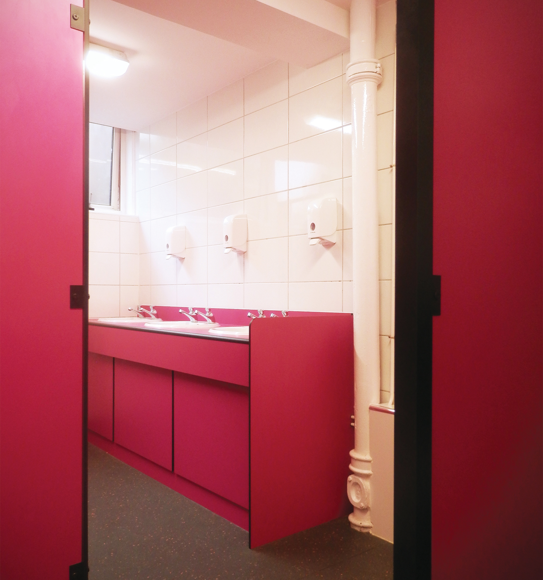 Washroom facilities featuring impact range Formica in custom  'Fushia'