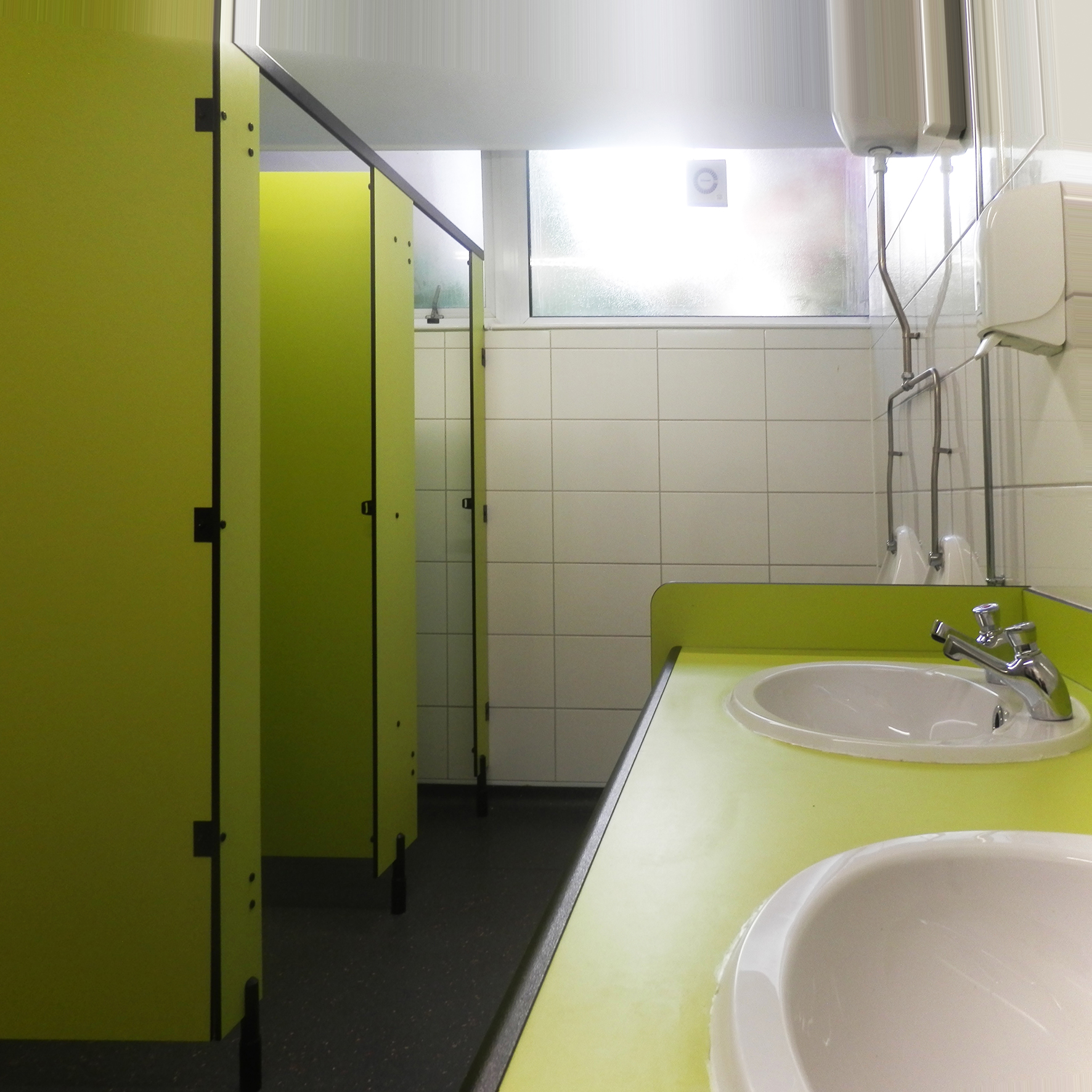 Washroom facilities featuring impact range Formica in custom lime zest